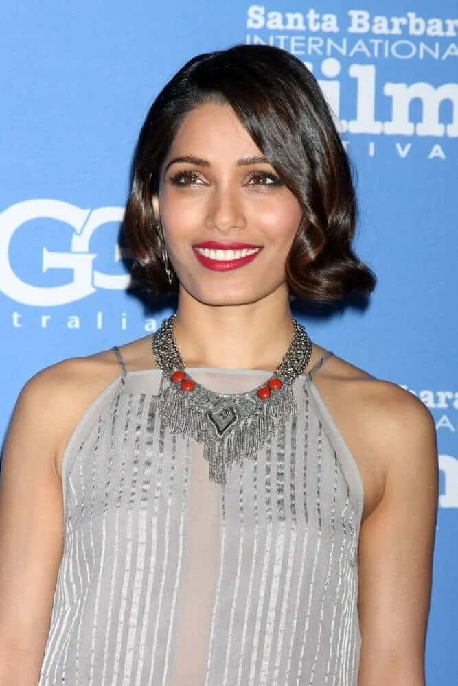 "Freida Pinto looked absolutely stunning with her swirly highlighted bob with a slight vintage nod at the US Premiere of ""Desert Dancer"" during the Santa Barbara International Film Festival, January 27, 2015."