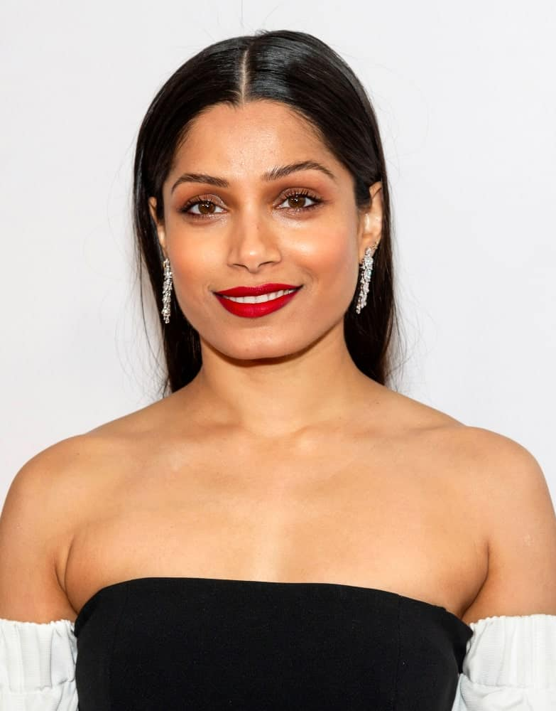 "Last April 27, 2019, Freida Pinto attended the World premiere of ""Only"" during the 2019 Tribeca Film Festival at SVA Theater with a slick and straight hairstyle parted in the middle to pair her bold lips."