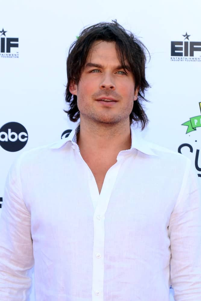 Ian Somerhalder rocked a messy hairstyle with his long locks at the EIF Presents: XQ Super School Live at the Barker Hanger on September 8, 2017. He complemented it with a white button-down polo for a fresh look.