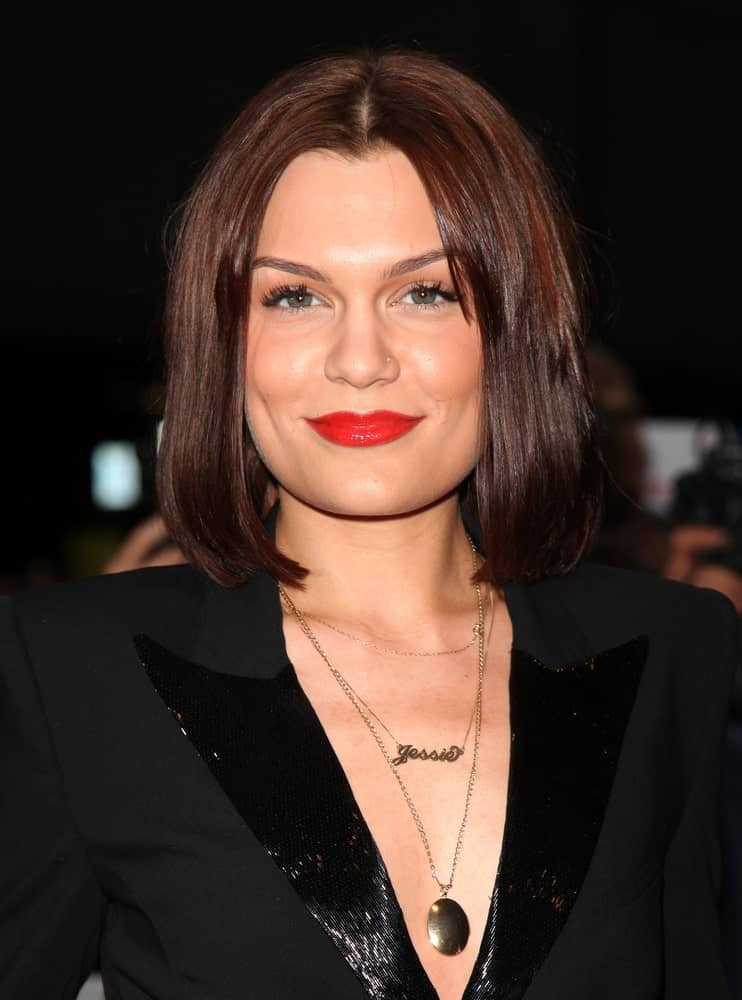 Jessie J attended the 2012 GQ Men Of The Year Awards at the Royal Opera House in London with a sexy smart suit with a deep V design paired with her center-parted long bob hairstyle with reddish highlights.