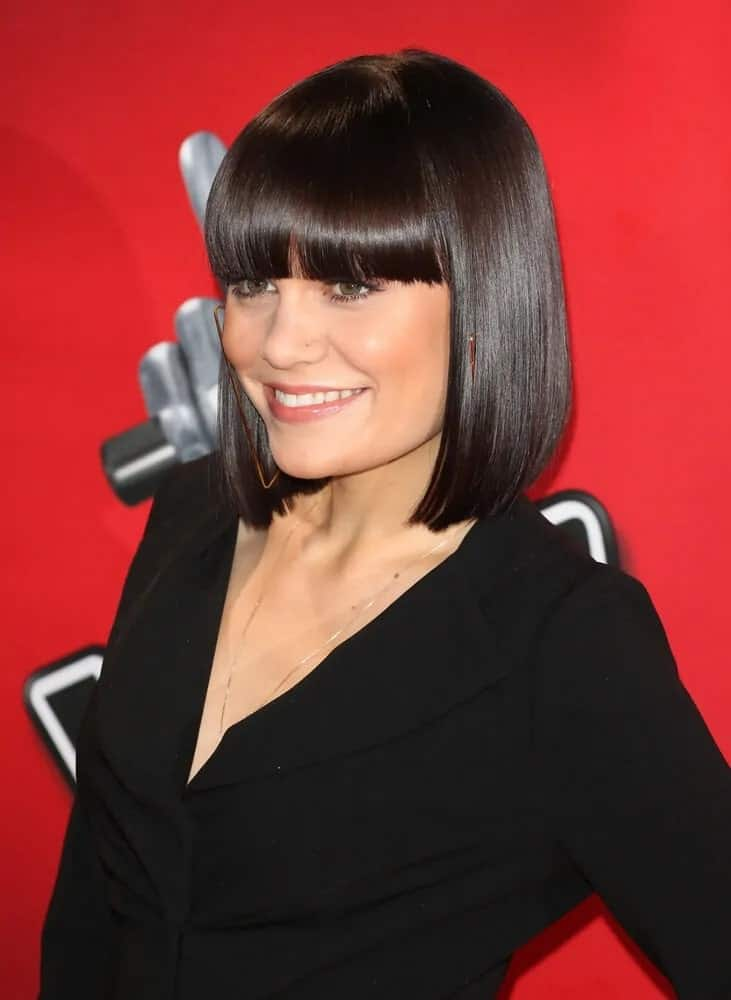 Jessie J went with this iconic look of straight raven bob with bangs paired with her black outfit last November 3, 2013 during the BBC's The Voice UK Launch Photocall.