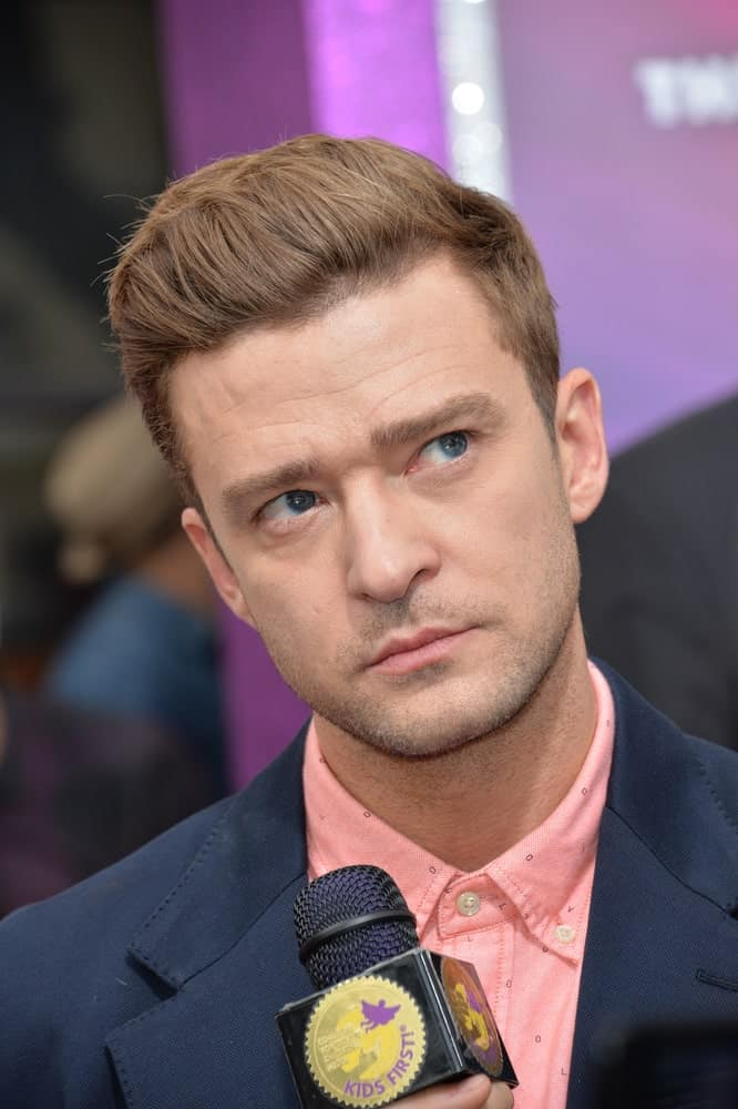 """Timberlake's hair is arranged in a brushed back pompadour style during the LA premiere of """"Trolls"""" last October 23, 2016. His hair has a slightly lighter shade to match the pink shirt and five o'clock shadow."""
