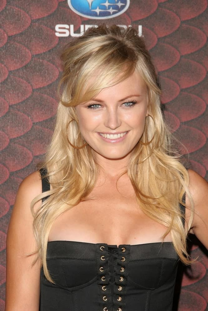 The youthful actress Malin Akerman was at Spike TV's 'Scream 2008' at the Greek Theatre last October 18, 2008. She wore a black corset bustier dress that is paired with a messy half-up long wavy blond hairstyle.