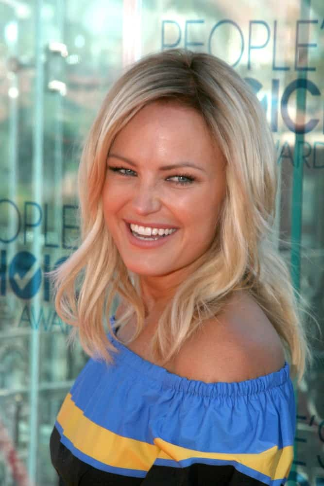 "Malin Akerman was at the ""People's Choice Awards"" 2011 Nominations Announcement in West Hollywood with her sunshine smile that is complemented by her sandy blond layered and tousled waves on her shoulders."