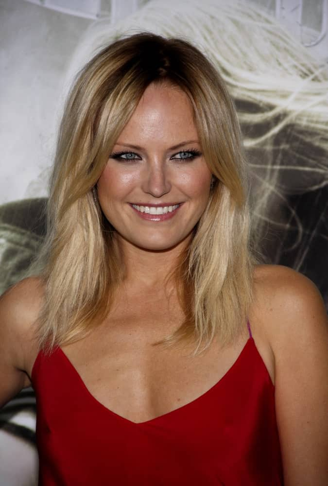 "Malin Akerman was at the Los Angeles Premiere of ""Sucker Punch"" held at the Grauman's Chinese Theater last March 23, 2011. She wore a bold and sexy red dress that complements her simple straight tousled loose hairstyle."