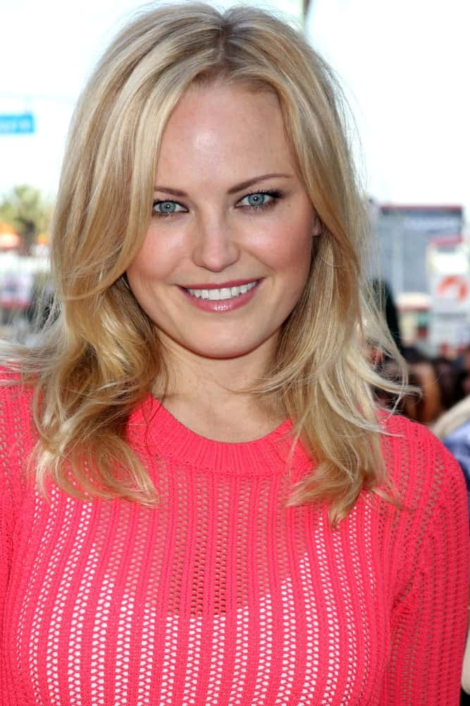 Malin Akerman showed her support for Jennifer Aniston at her Walk of Fame Ceremony last February 22, 2012 in Hollywood. The actress wore a simple pink woven dress and her blond layers were slightly tousled and wavy.