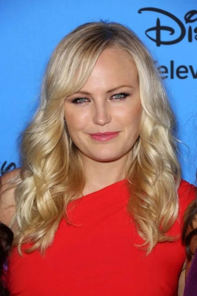 Malin Akerman had a sophisticated red dress paired with her loose and layered blond waves and side-swept bangs at the ABC Summer 2013 TCA Party.