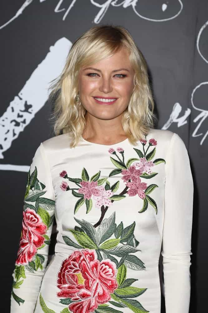 "Actress Malin Akerman attended the ""mother!"" premiere at Radio City Music Hall last September 13, 2017 in New York City wearing a floral white dress elevated by her simple yet elegant side-parted blond bangs and wavy hairstyle."
