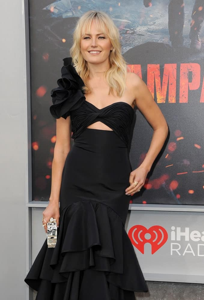 Malin Akerman wore a sophisticated and sexy black dress at the Los Angeles premiere of 'Rampage' held at the Microsoft Theater last April 4, 2018. It pairs well with her tousled long wavy hair and wispy bangs.