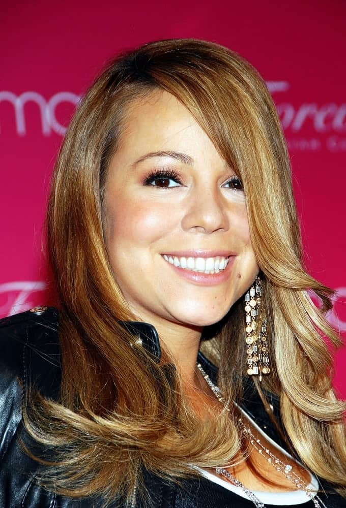 "The singer was sporting a medium-length, golden blonde hair with swoopy layers to match her casual look last 2009 for the launch of her new fragrance called ""Forever"" at Macy's Herald Square Department Store, New York, NY."