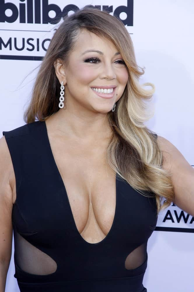 Mariah Carey had her hair styled with light tones and layers swept one side that brings focus onto her beautiful diamond earrings. This look was worn for the 2015 Billboard Music Awards.