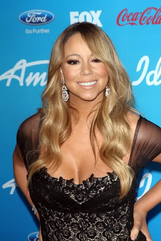 Mariah Carey smiles at the