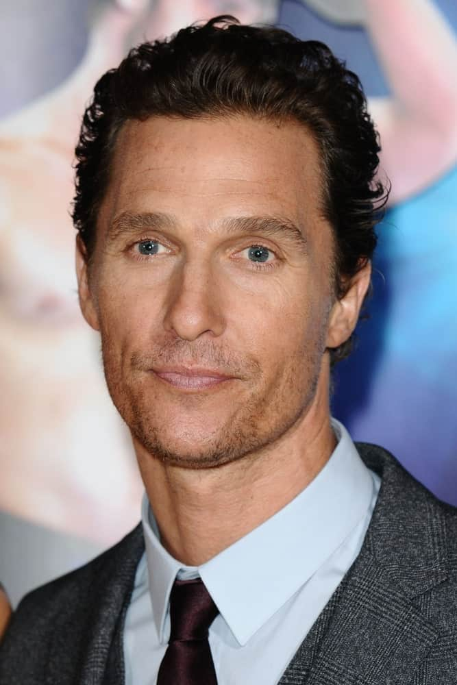 "Matthew McConaughey was spotted at the ""Magic Mike"" premiere in London last October 7, 2012 tamed wavy hair brushed back with a casual finish."