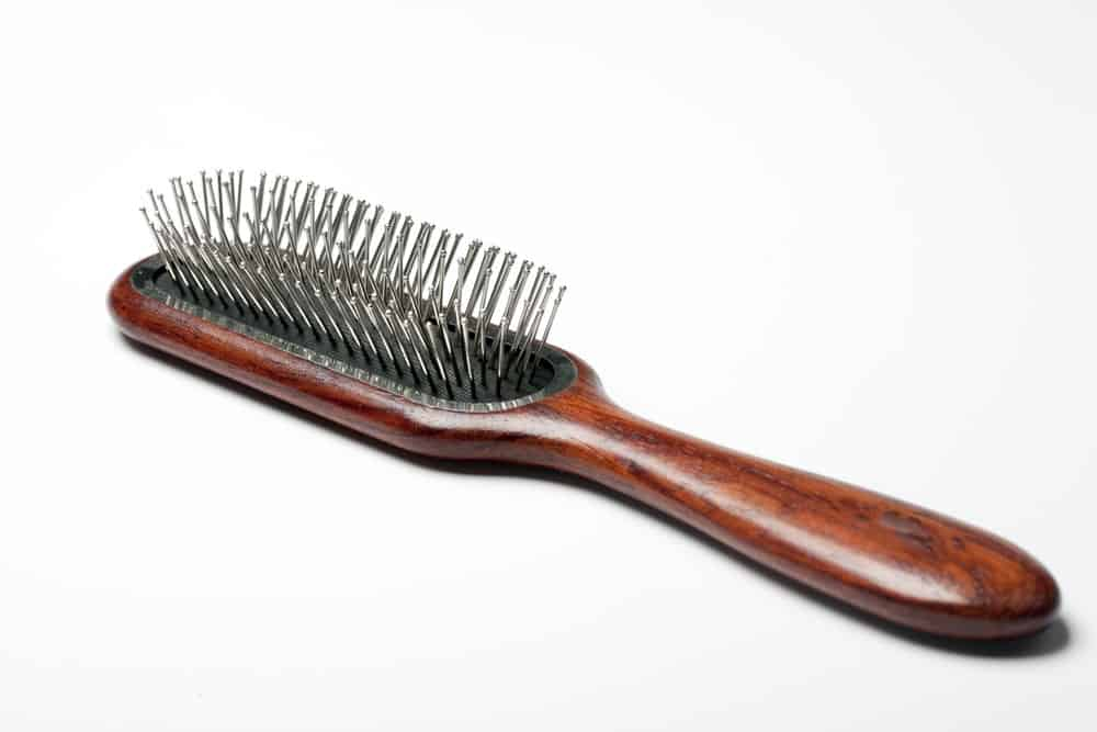 Hair brush with metal bristles.