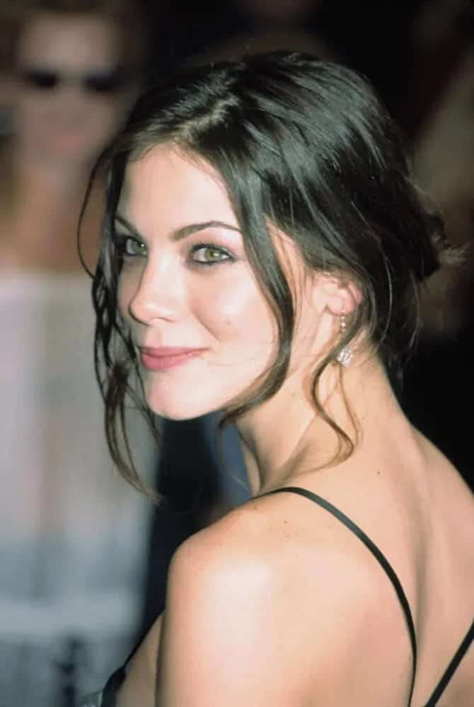 "This is a youthful Michelle Monaghan that flaunted her simple, messy updo with tendrils. This photo was taken last April 13, 2003 at the NY premiere of ""It Runs in the Family""."