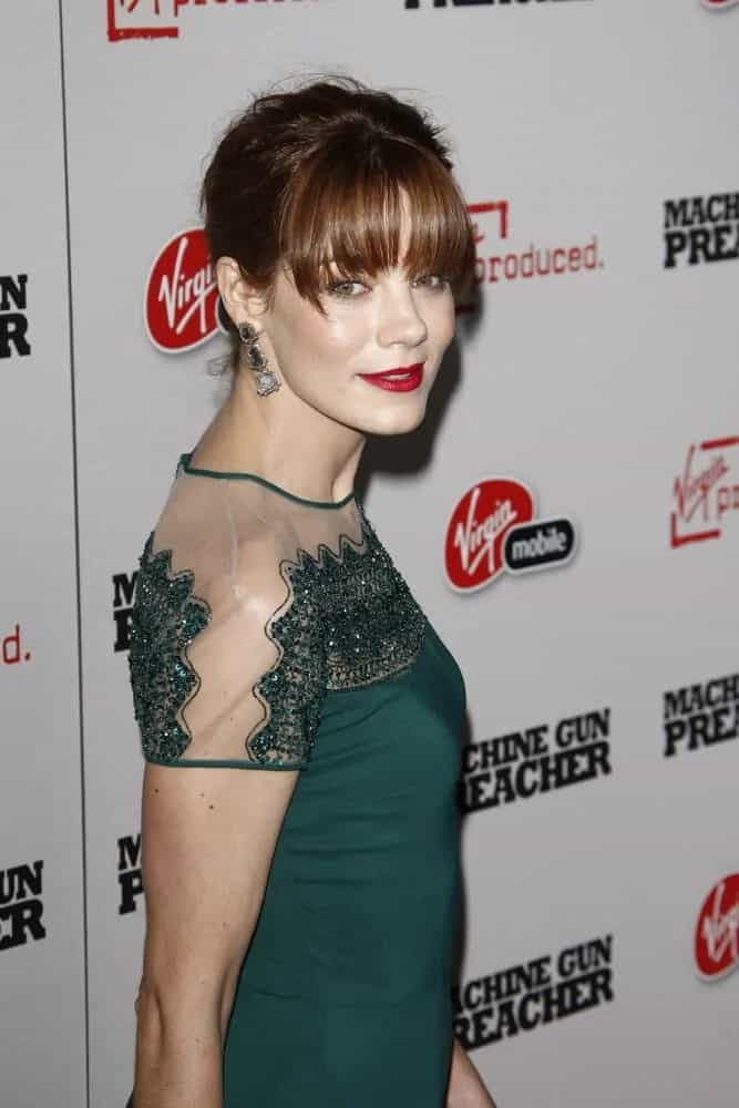 """This trend-setter actress wore a gorgeous green dress during the premiere of """"Machine Gun Preacher"""" last September 21, 2011. She had her bangs paired with a slightly messy updo."""