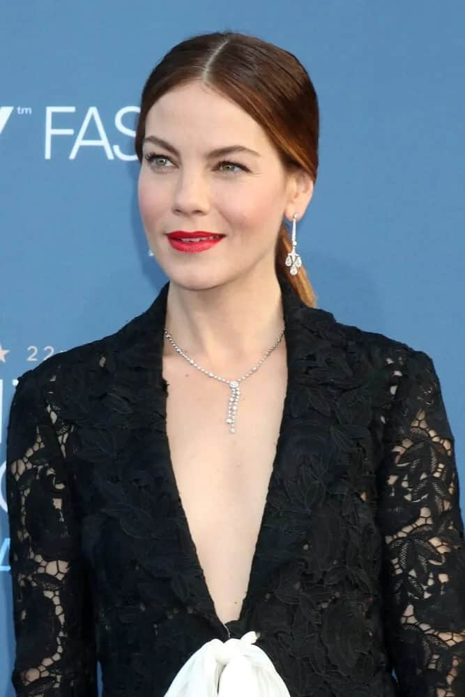 The actress wore a low ponytail hairstyle with highlights that complement her black doily dress at the 22nd Annual Critics' Choice Awards, December 11, 2016.
