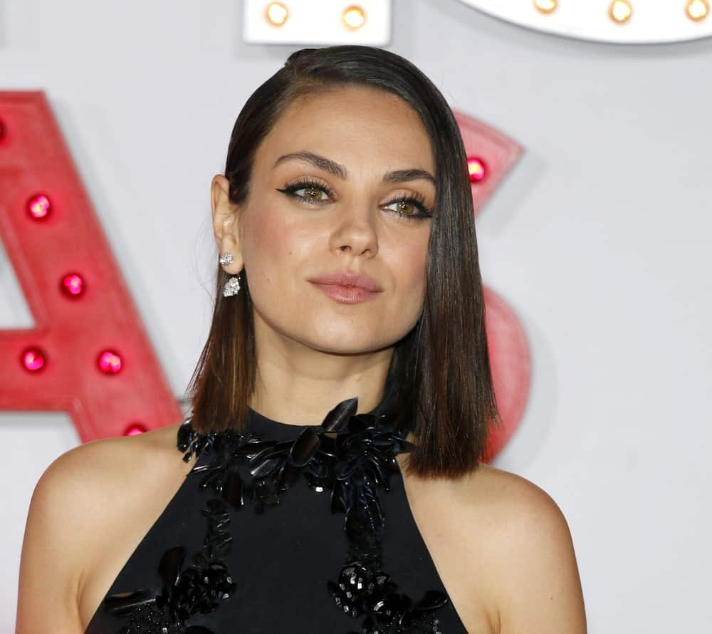 Mila Kunis was gorgeous with her black detailed dress and straight bob hairstyle with subtle highlights at the premiere of 'A Bad Moms Christmas' held at the Regency Village Theatre in Westwood last October 30, 2017.