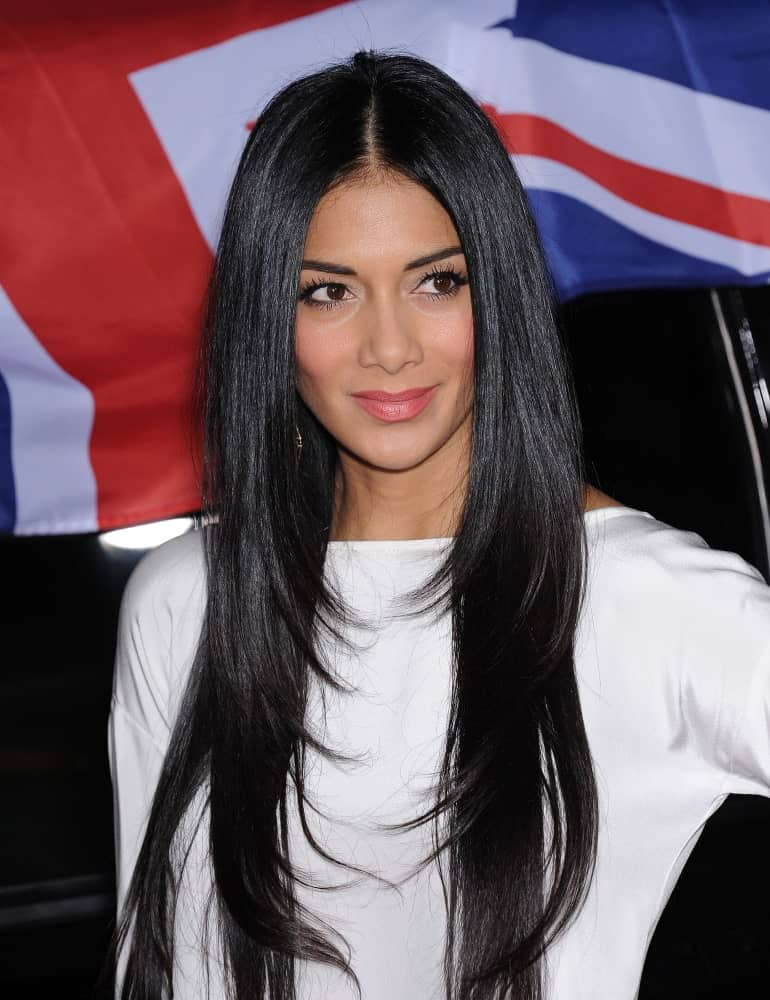 The famous singer exhibited her long layered hair during the Topshop Topman Store Opening Party on February 13, 2013, along with a white dress that completed her sleek look.
