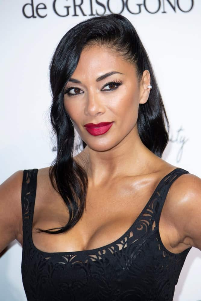Nicole Scherzinger rocks a high ponytail hairstyle incorporated with wavy side-parted hair that's gathered on the left side. She paired it with a chic black dress that she wore during the 71st annual Cannes Film Festival in Antibes last May 15, 2018.