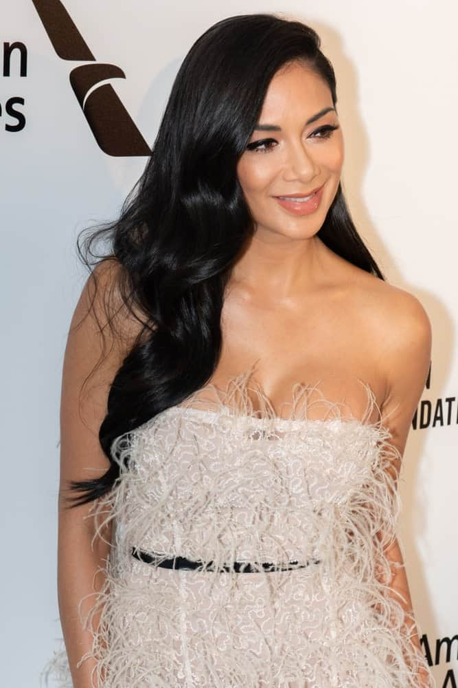 Last February 24, 2019, at the 27th Annual Elton John AIDS Foundation Academy Awards Viewing Party Celebrating EJAF And The 91st Academy Awards, the singer showed up in a furry dress and her naturally black hair side-parted with big waves.