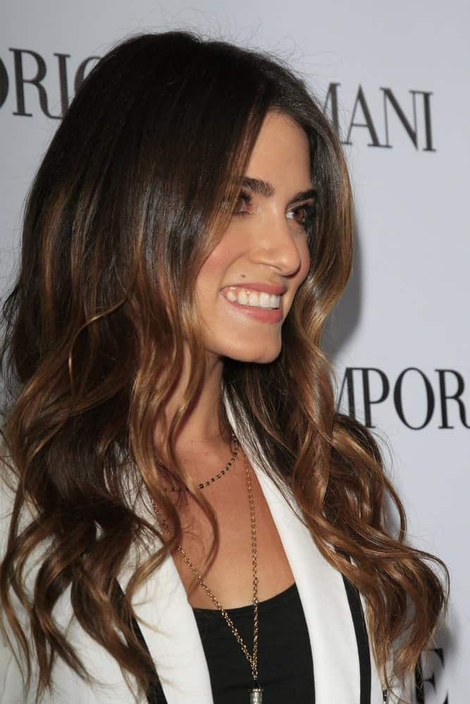 Nikki Reed had her brunette locks permed during the Teen Vogue's 10th Annual Young Hollywood Party at Private Location on September 27, 2012. The look was completed with a black top and white blazer paired with a layered necklace.