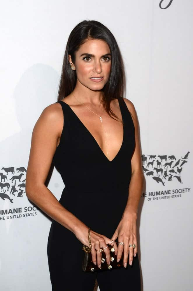 Nikki Reed showing off her sleek black hair that's loose and side-parted during the Humane Society Of The United States LA Gala at the Paramount Studios on May 7, 2016. It perfectly goes well with her jumpsuit getup with a deep V neckline.