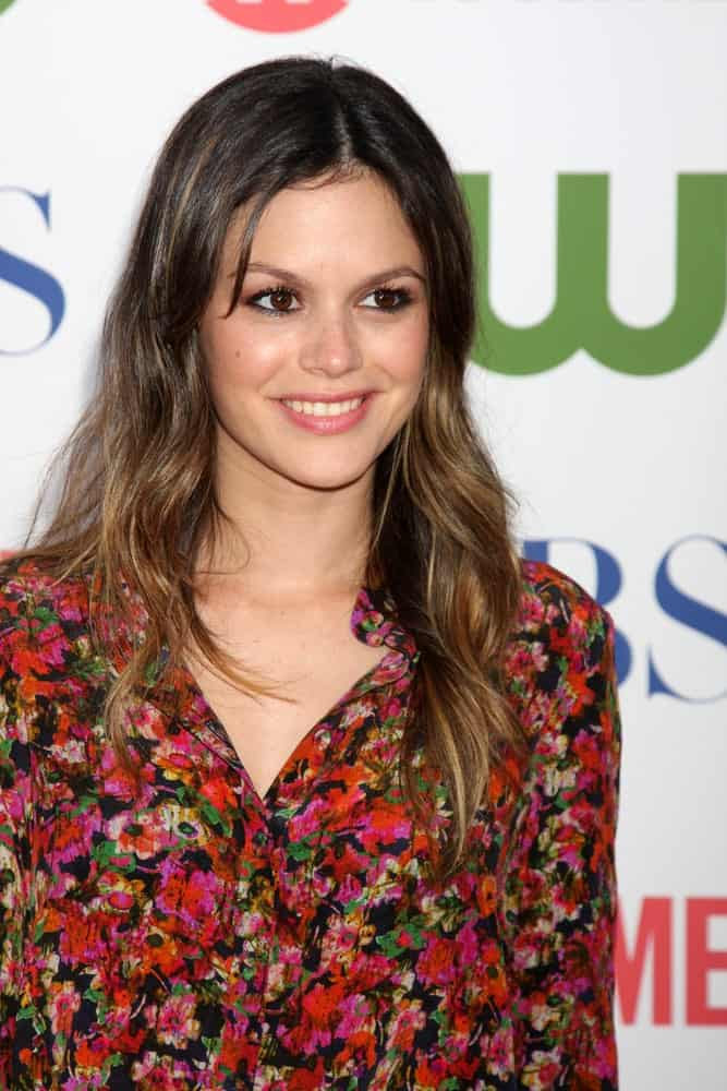 Rachel Bilson was seen at the CBS TCA Summer 2011 All Star Party at Robinson May Parking Garage on August 3, 2011, in a floral top and tousled highlighted hair. It was center-parted with subtle dark roots showing up.