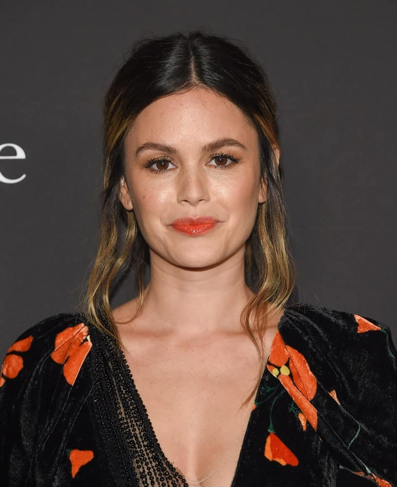 The actress attended the 2019 InStyle Awards on October 21st with a messy updo that's center-parted. Black velvet floral dress with deep V neckline completed the charming look.