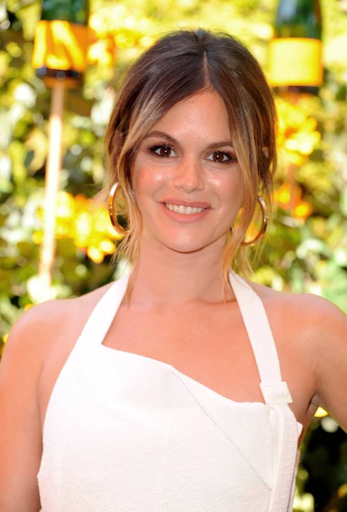 Rachel Bilson looked classy in a white halter dress and gold hoop earrings accentuated by luxe upstyle hairstyle with long curtain bangs. It was worn at the 10th Annual Veuve Clicquot Polo Classic held on October 5, 2019.