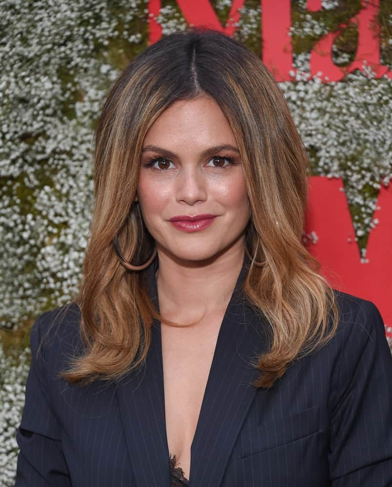 Rachel Bilson looking sharp in a navy blue suit with her voluminous copper brown dyed hair center-parted and partially curled. This was taken during the InStyle Max Mara Women In Film Celebration on June 11, 2019.