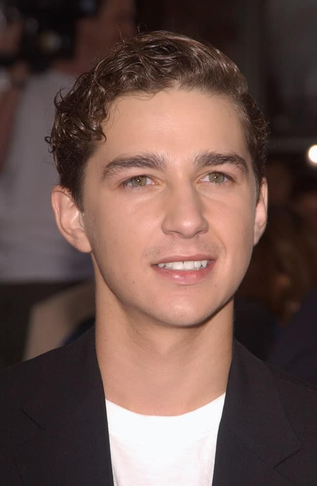 The actor had his short curly hair into an elegant side-parted sleek finish at the world premiere, in Los Angeles, of his new movie I, Robot last July 7, 2004. He matched this with a simple black suit and white shirt.