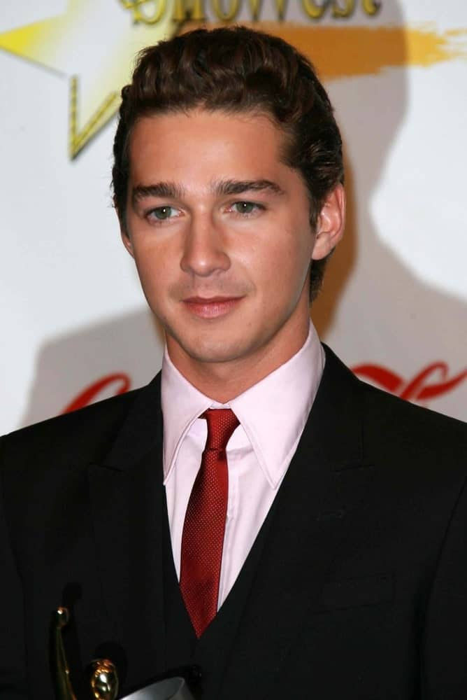 Shia LaBeouf was at the ShoWest 2007 Awards Ceremony in Las Vegas. He was wearing a dark suit paired with a red tie finished off by his classy pompadour curly hairstyle.