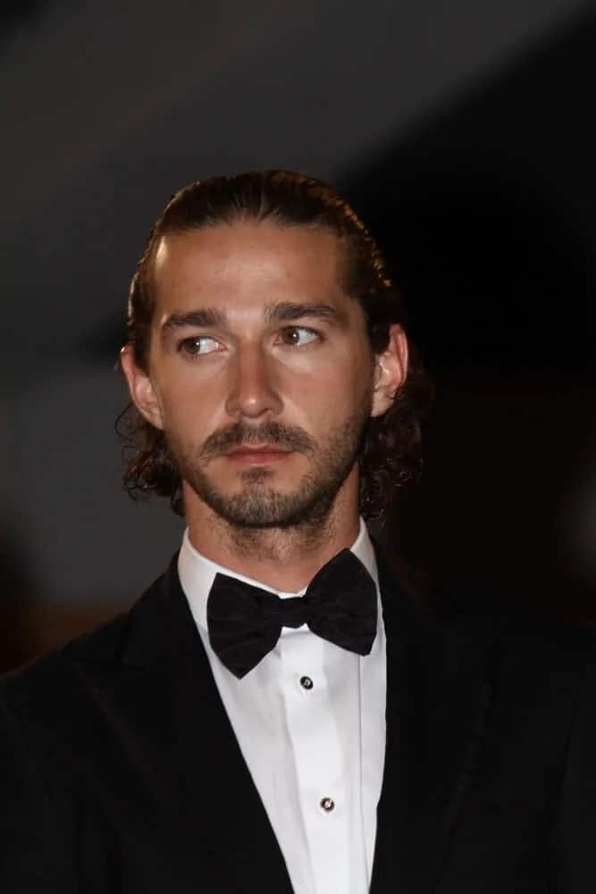 Shia LaBeouf's long curly hair was styled into this neat slicked back look matched with a well-trimmed beard last May 19, 2012 for the 65th Annual Cannes Film Festival.