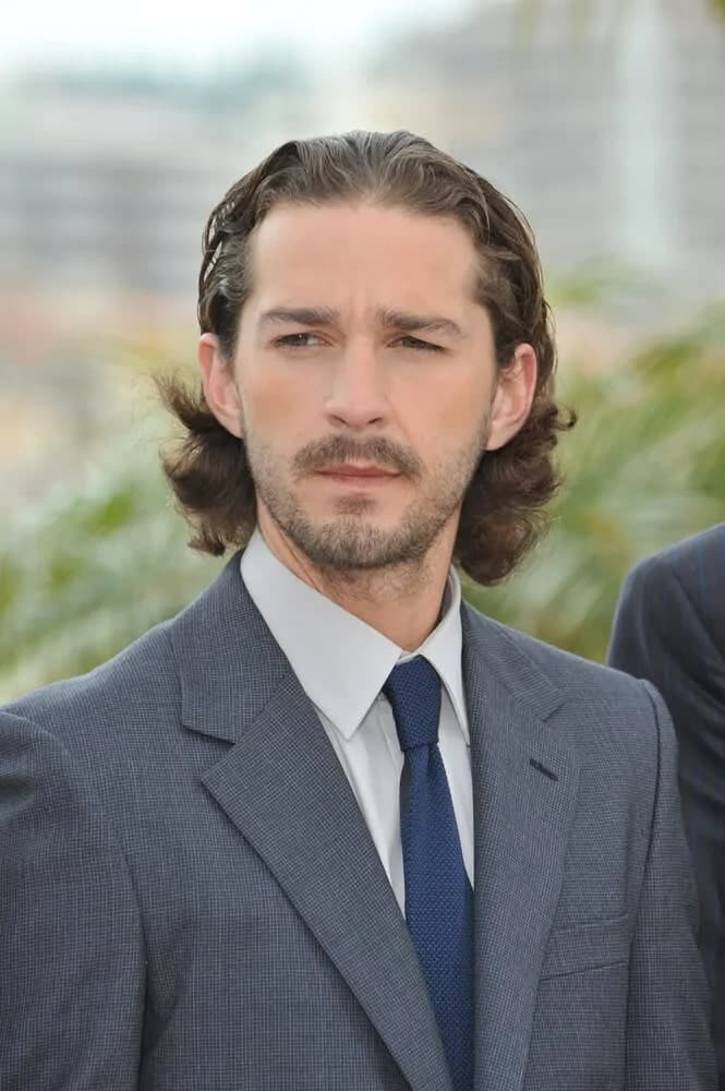 """May 19, 2012 was when Shia LaBeouf had a brush up hairstyle to his long dark brown curls during the photocall for his new movie """"Lawless""""."""