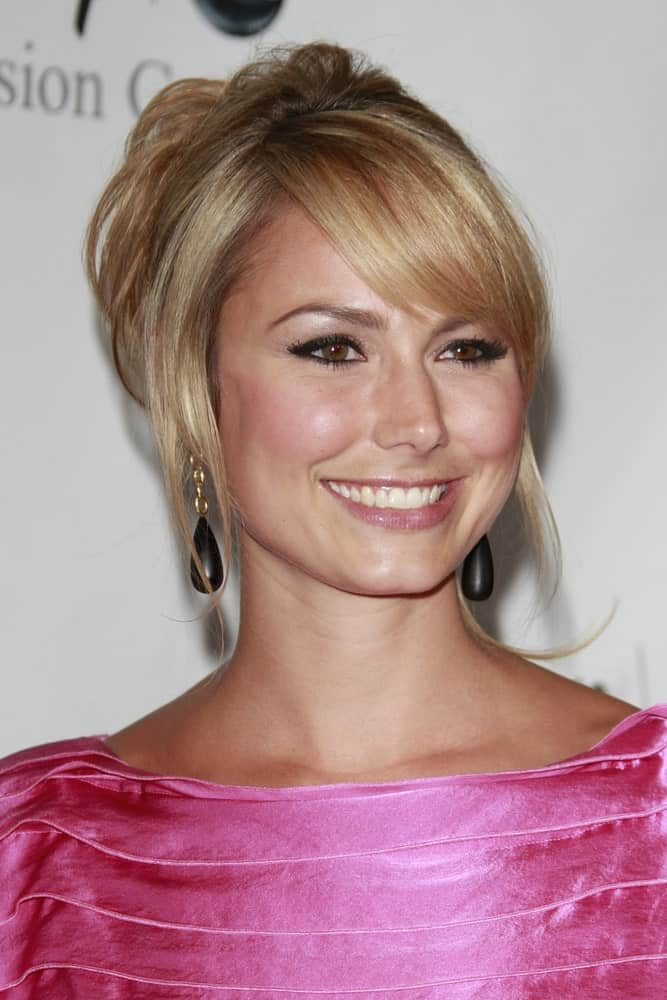 The model at the Disney ABC Television Group Summer All Star party last July 12, 2008, showcasing a sweet and charming aura with her upstyle hairstyle. It is paired with a pink dress that complements her flushed makeup look.