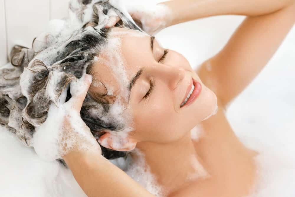 Woman shampooing her hair.
