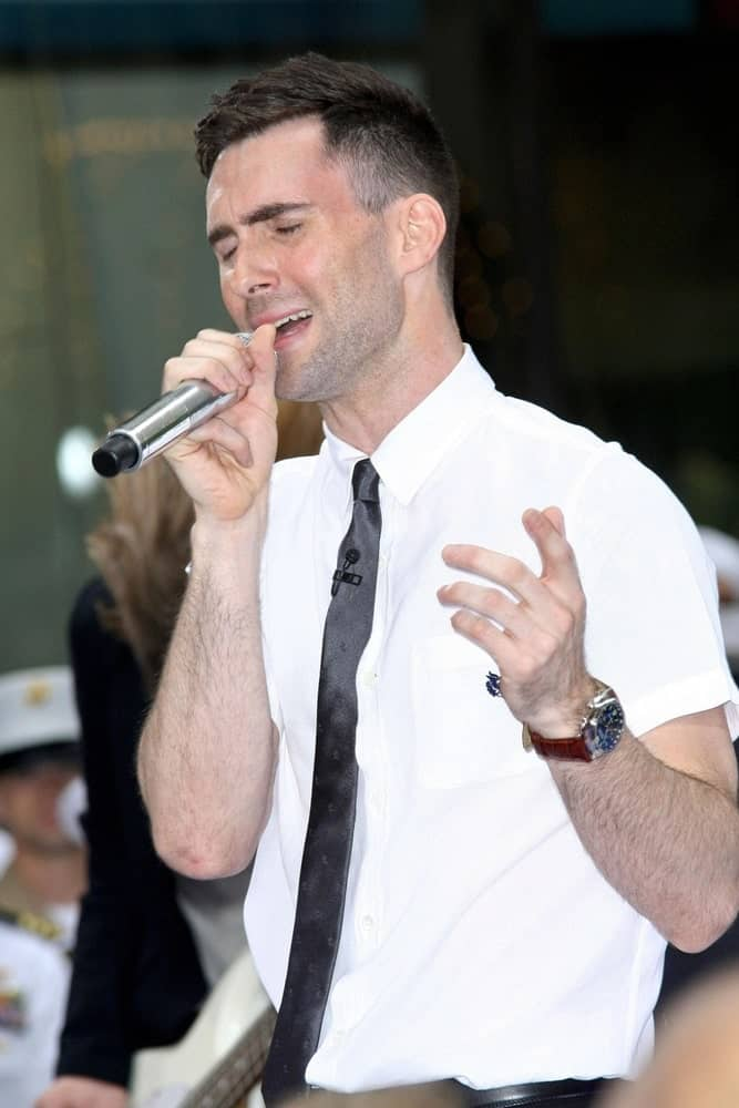 Adam Levine was on stage for NBC Today Show Concert with Maroon 5 held at the Rockefeller Center in New York on May 28, 2007. Levine paired his neat five o'clock shadow with a fade crew cut side parted hairstyle.