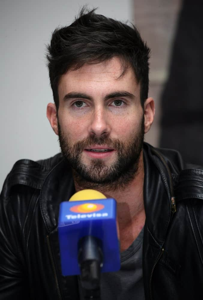 Lead vocalist of Maroon 5 Adam Levine attended the press conference before a performance at the Palacio de los Deportes in Mexico City on November 4, 2008. He was handsome with his full beard and tousled undercut hairstyle.