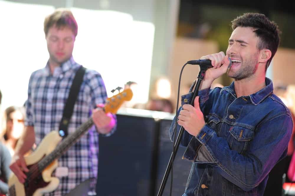 Adam Levine was on stage for NBC Today Show Concert with Maroon 5 in New York on July 2, 2010. He paired his edgy denim jacket with a side-parted fade hairstyle and five o'clock shadow.
