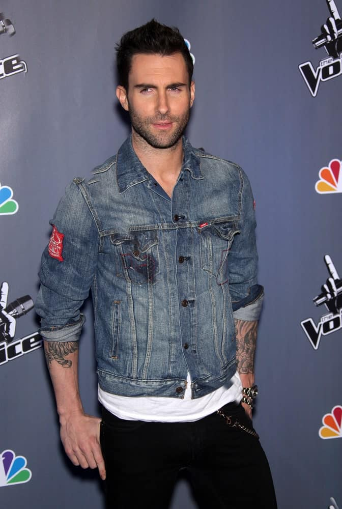 "Adam Levine's spiked crew cut hairstyle is a nice complement to his edgy denim jacket when he attended the Press Junket for ""The Voice"" on March 15,2011 in Los Angeles, CA."