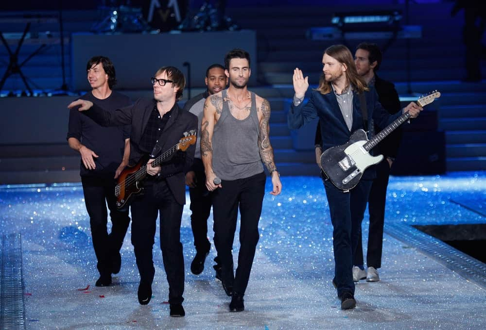 Members of Maroon 5 walked the runway during the 2011 Victoria's Secret Fashion Show on November 9, 2011 in New York City. Levine wore an edgy gray wife beater with his dress pants and leather shoes to match his pompadour hairstyle.