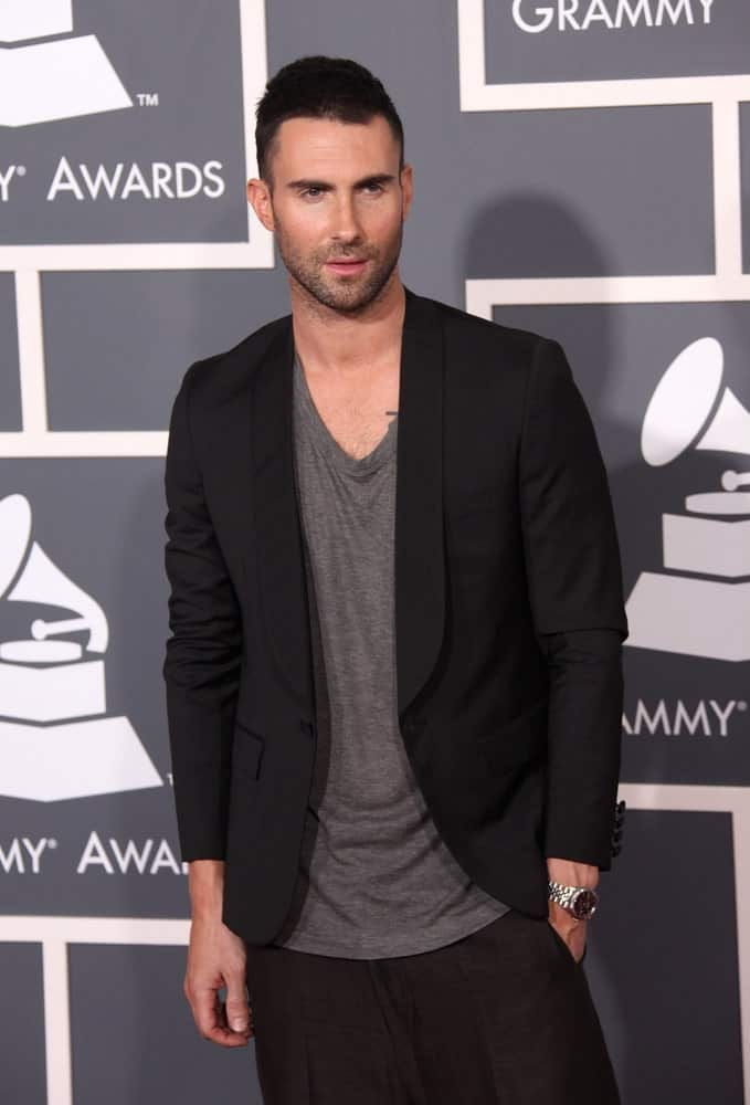Adam Levine was quite stylish in his baggy outfit and his Caesar fade hairstyle when he arrived at the 2011 Grammy Awards on February 13, 2011 in Los Angeles, CA.