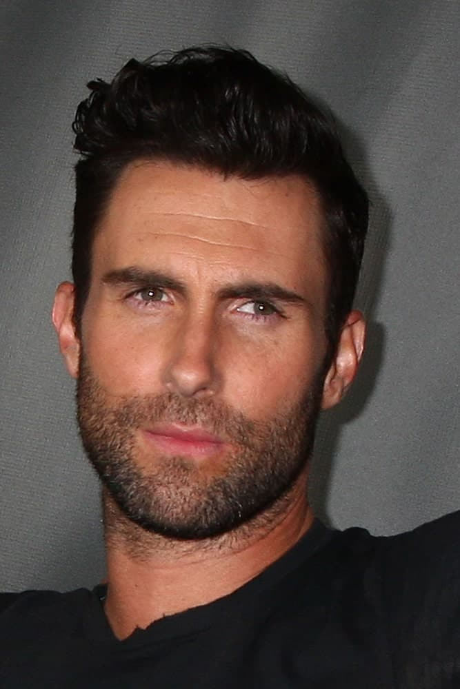 Adam Levine exuded confidence with his casual black shirt and undercut styled into a side-swept pompadour at