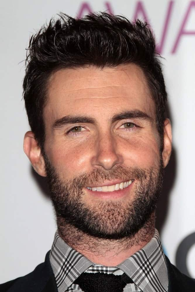 Adam Levine paired his handsome trimmed beard with a stylish spiked hairstyle and a patterned button shirt at the 2013 People's Choice Awards Press Room in Los Angeles, CA on January 9, 2013.