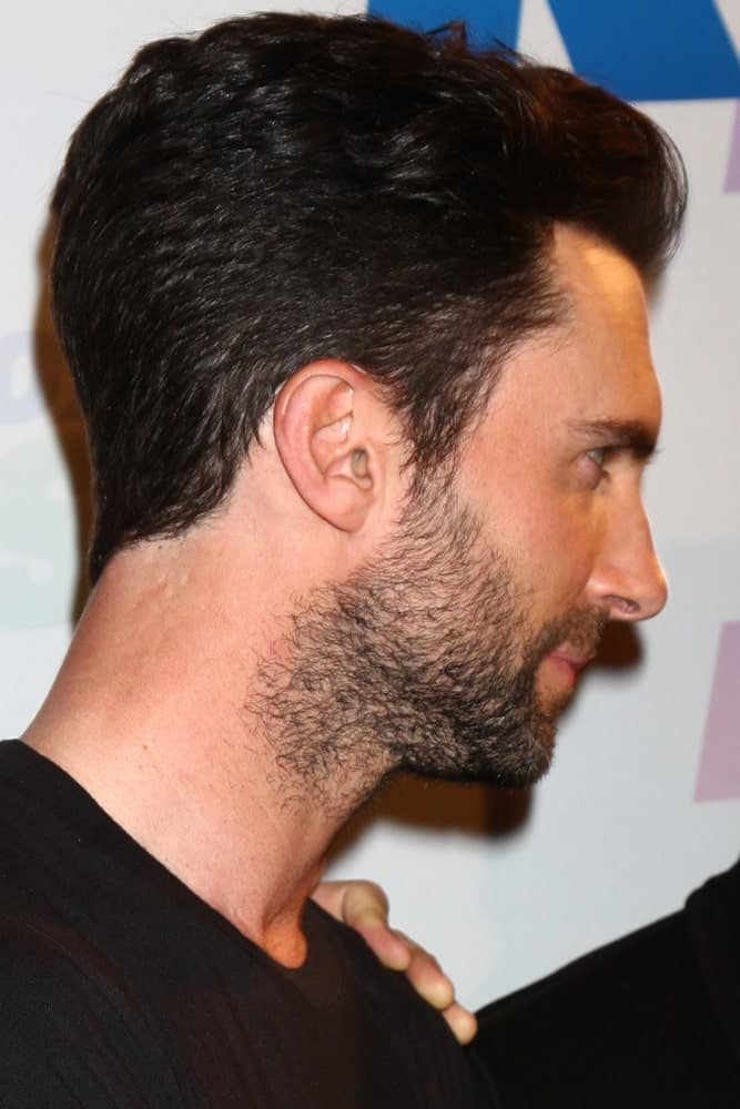A side view of Adam Levine featuring how his pompadour fade hairstyle integrates with his trimmed beard when he attended the 2013 Wango Tango concert produced by KIIS-FM on May 11, 2013 in Carson, CA.