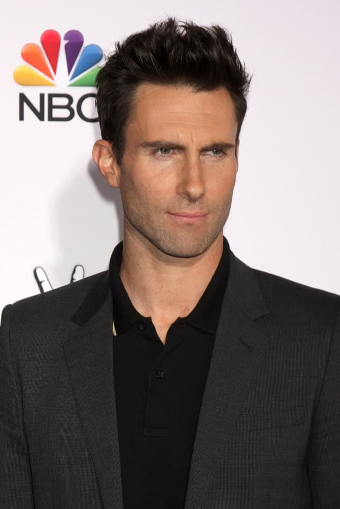 Adam Levine's sexy five o'clock shadow pairs quite well with his brushed-up spiked fade hairstyle at the