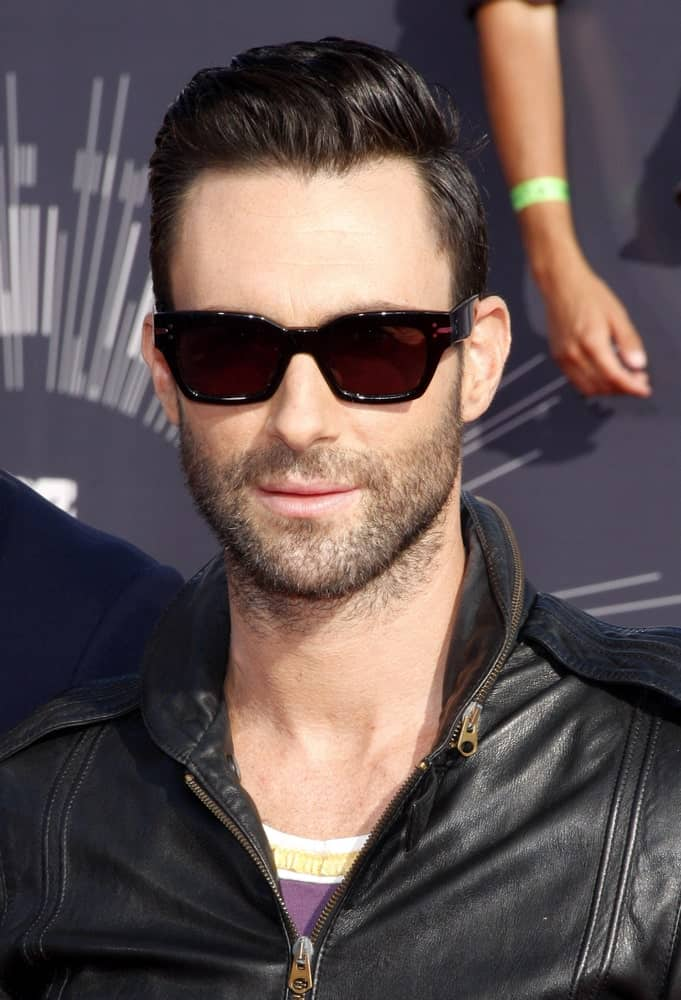 Adam Levine's sexy sunglasses were a nice pair for his vintage look of black leather jacket and slick pompadour hairstyle at the 2014 MTV Video Music Awards on August 24, 2014 in Los Angeles, California.