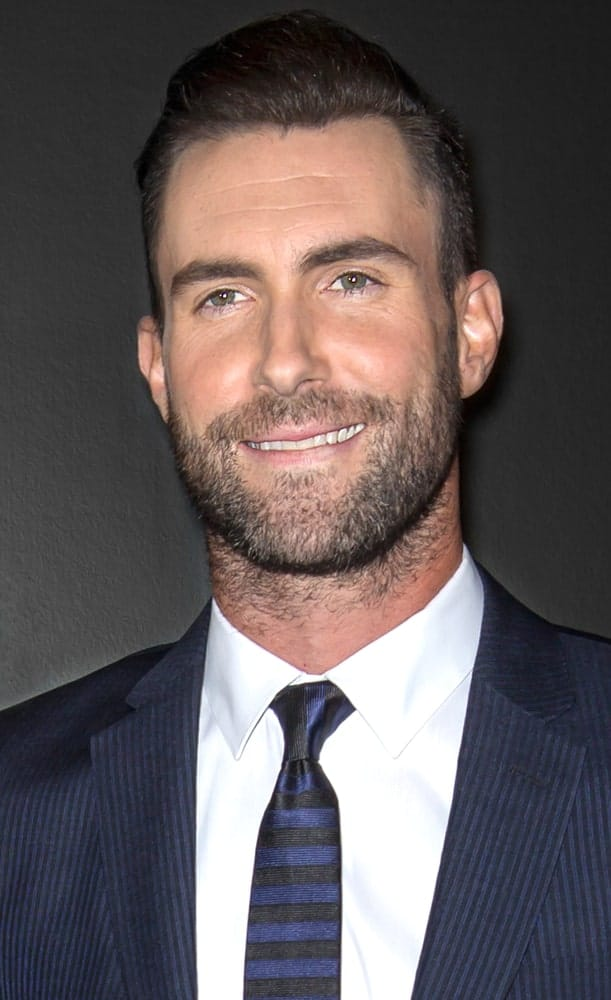 Adam Levine attended the closing night gala premiere of 'Begin Again' during the 2014 Tribeca Film Festival at BMCC Tribeca PAC. He was dapper in his blue suit and brushed up slick pompadour hairstyle and trimmed beard.