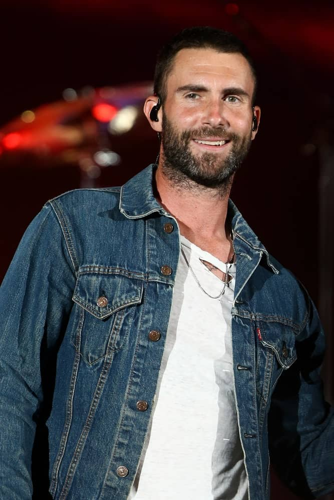 Adam Levine rocked the stage with a short buzz cut hairstyle and full beard during the CBS Radio's third annual We Can Survive at the Hollywood Bowl on October 24, 2015 in Hollywood, California.
